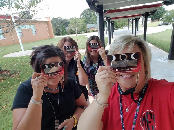 Mrs. Scott, Mrs. Laura, Mrs. Julie, and Ms. Norris take a selfie during the eclipse!